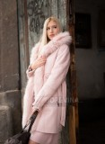 A beautiful young blonde in a pink furry coat.