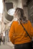 Orange wool sweater and black leather pants.