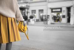 Yellow skirt and yellow women's purse.