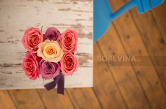 Vintage photo with beautiful roses in a hand-made box ..