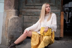 A beautiful girl with long blond hair in a yellow